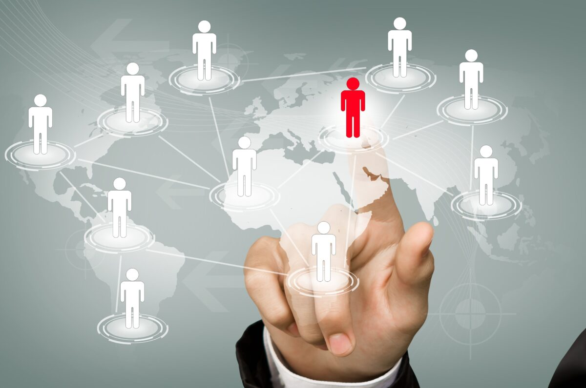 businessman-touching-a-red-icon-connected-min