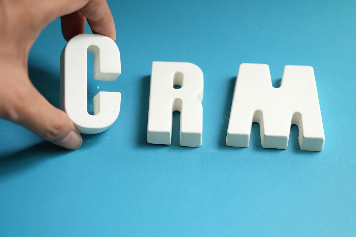 hand-arrange-white-letters-as-crm-min