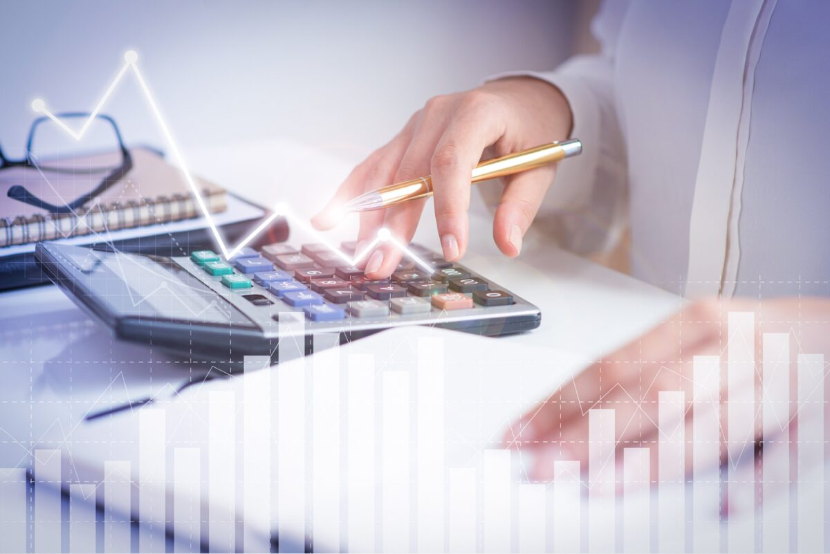 accountant-calculating-profit-with-financial-analysis-graphs-min