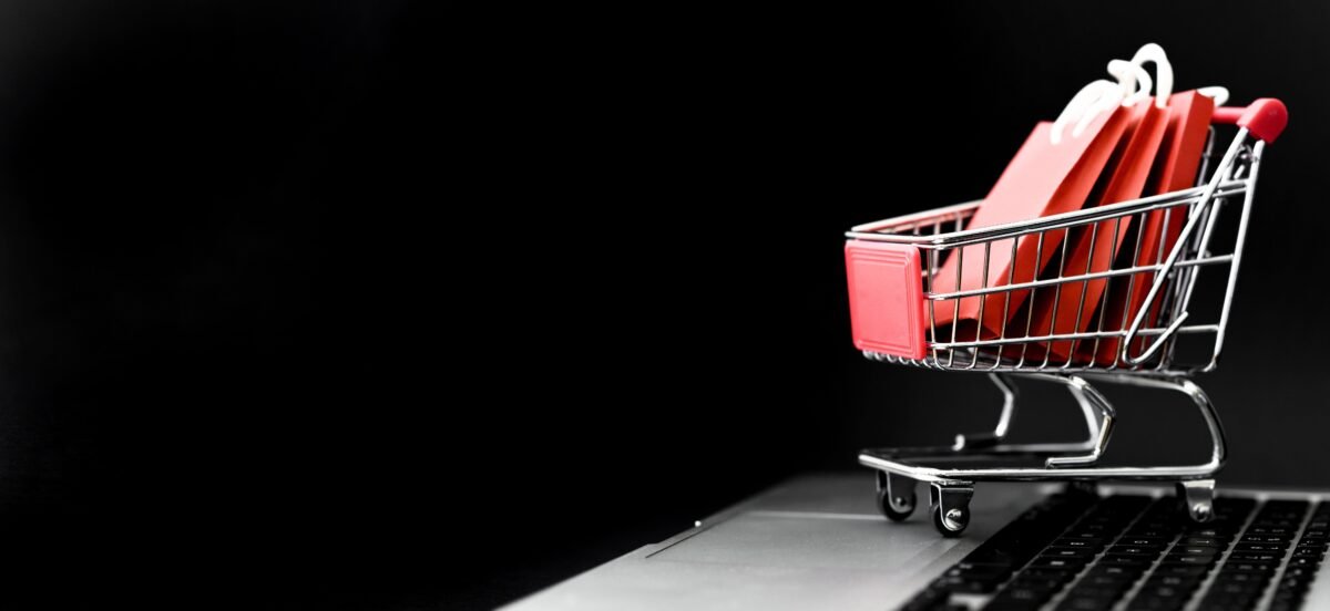 front-view-cyber-monday-shopping-cart-with-bags-copy-space-min