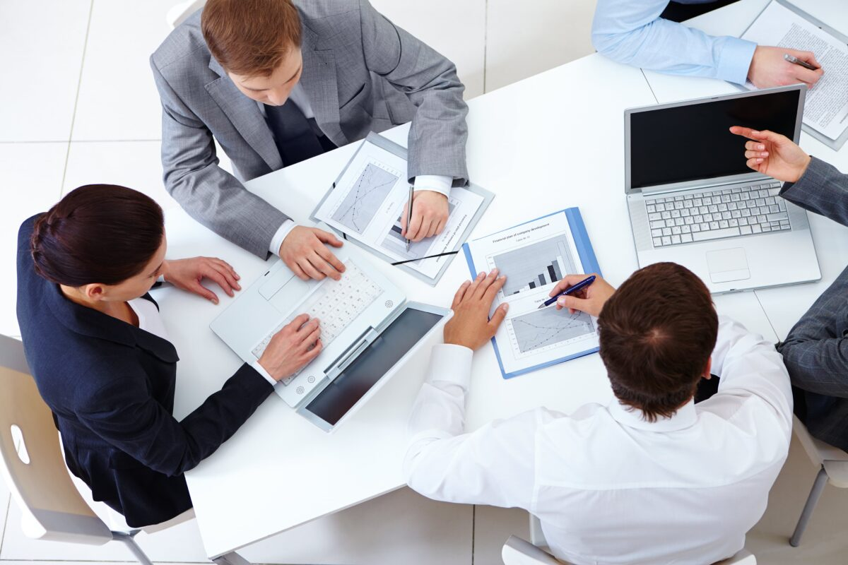 top-view-co-workers-planning-strategy-min