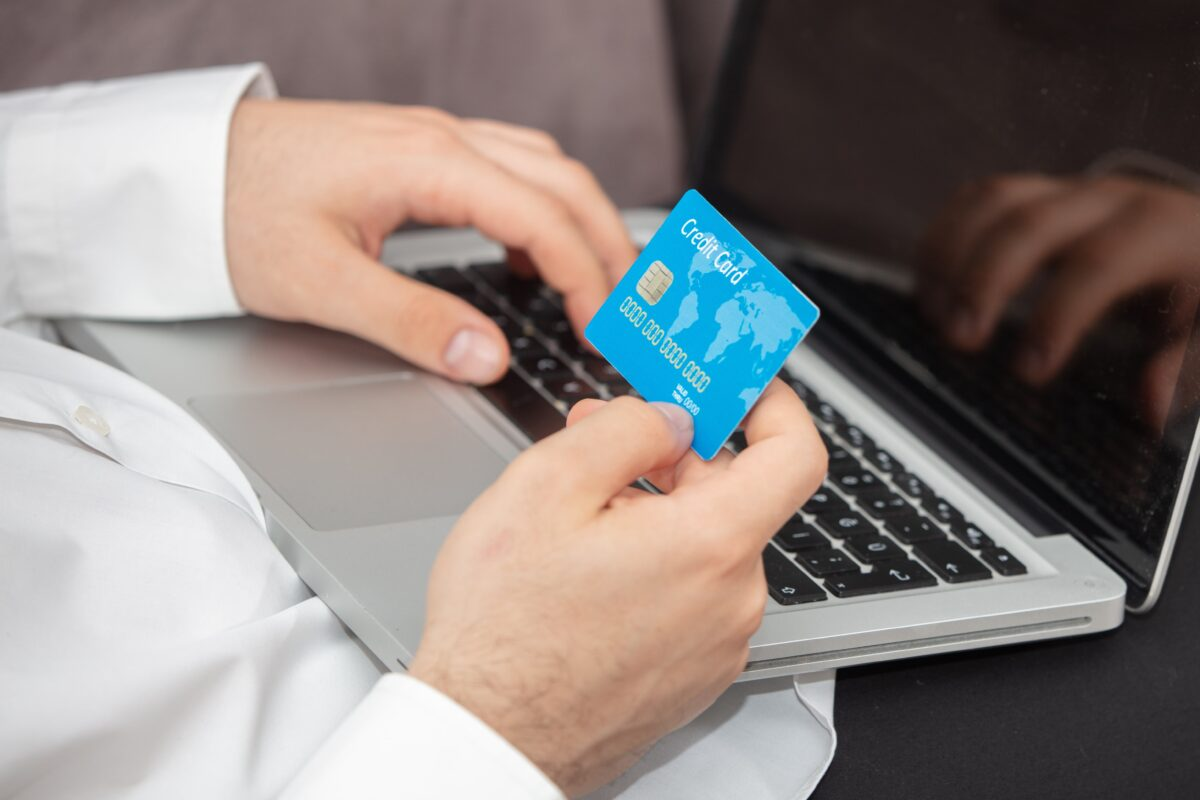 person-inputting-details-its-credit-card-laptop-min