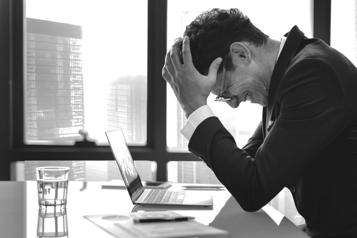 stressed-young-businessman-overworking-min