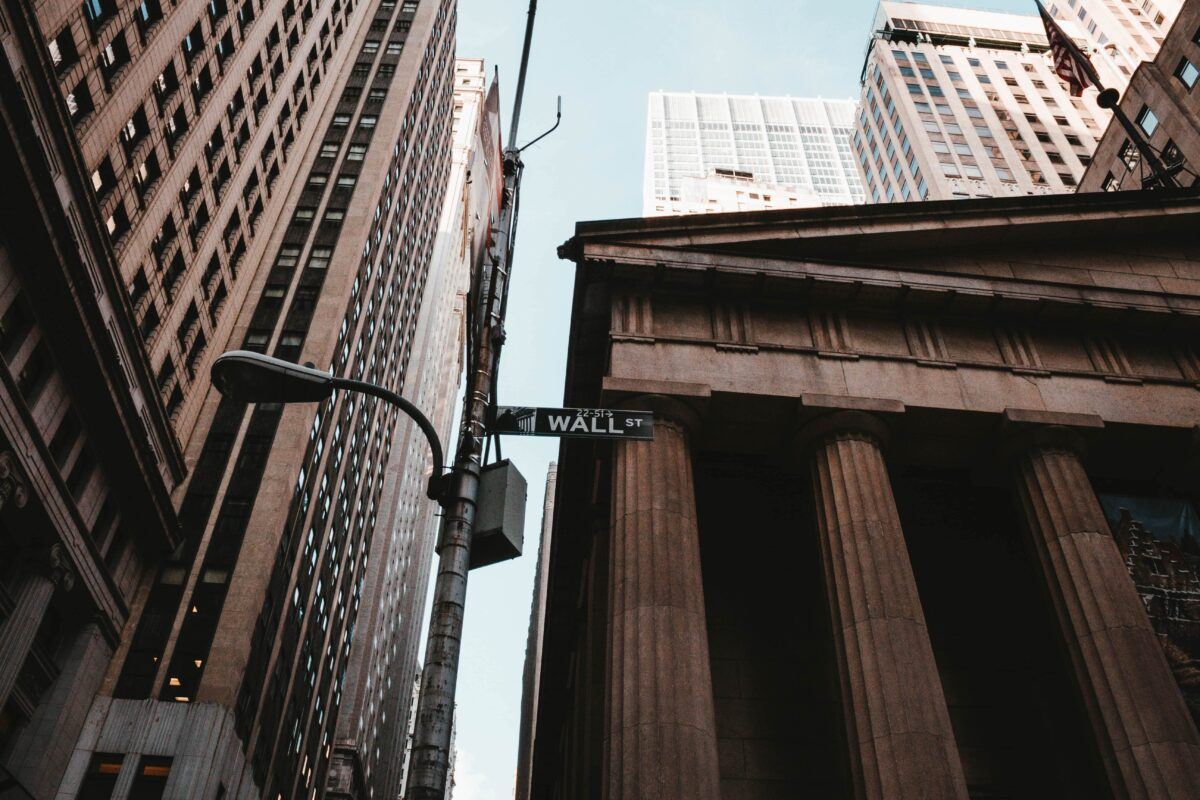 low-angle-shot-of-wall-street-sign-in-nyc-min