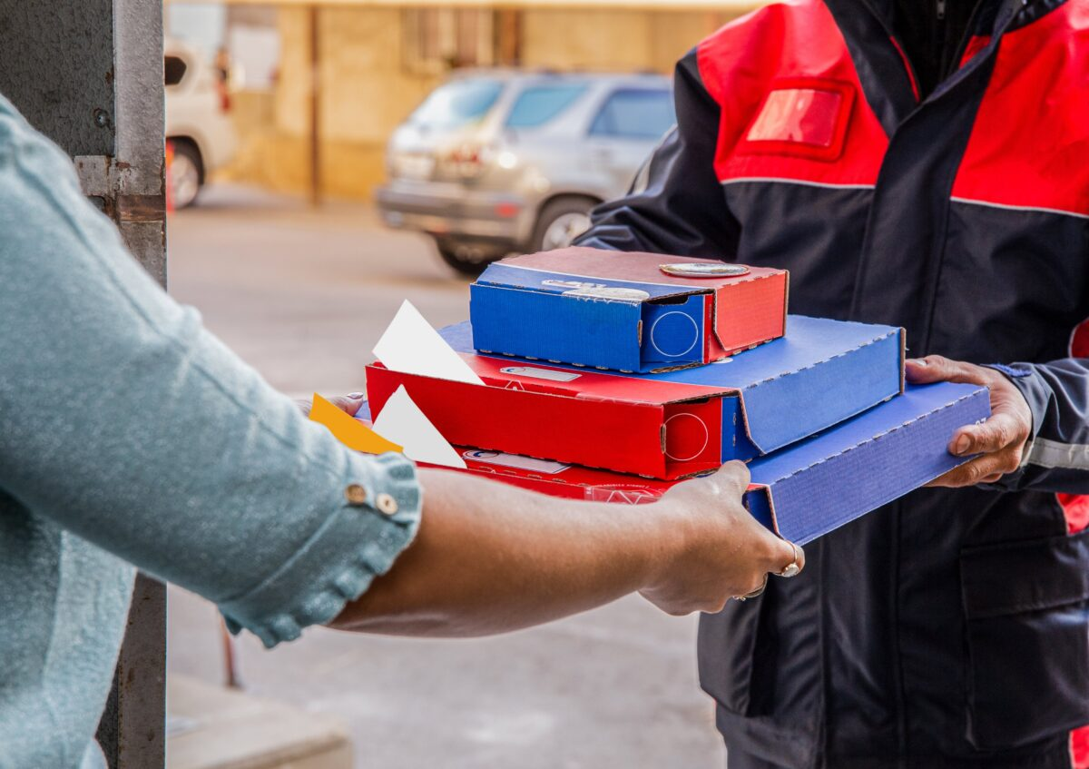 pizza-delivery-courier-giving-pizza-boxes-person-min
