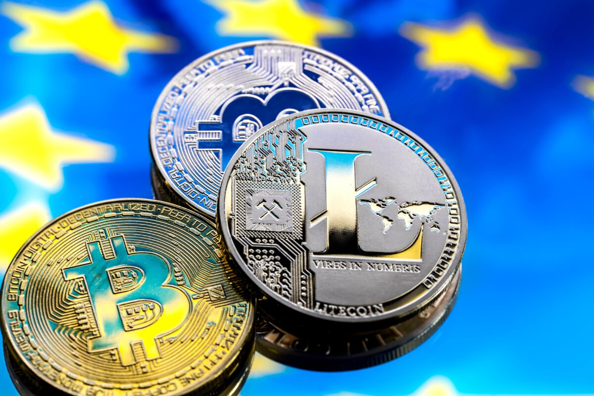 coins-bitcoin-and-litecoin-against-the-background-of-europe-and-the-european-flag-the-concept-of-virtual-money-close-up-min