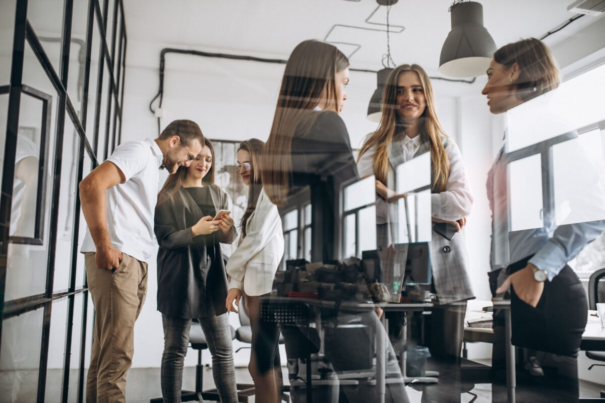 group-of-people-working-out-business-plan-in-an-office-min