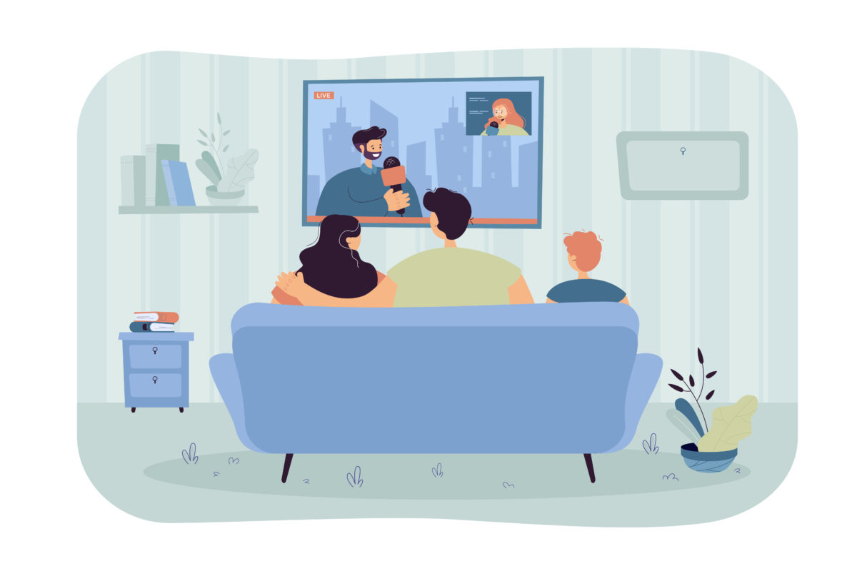 Happy family with kid sitting on sofa and watching news