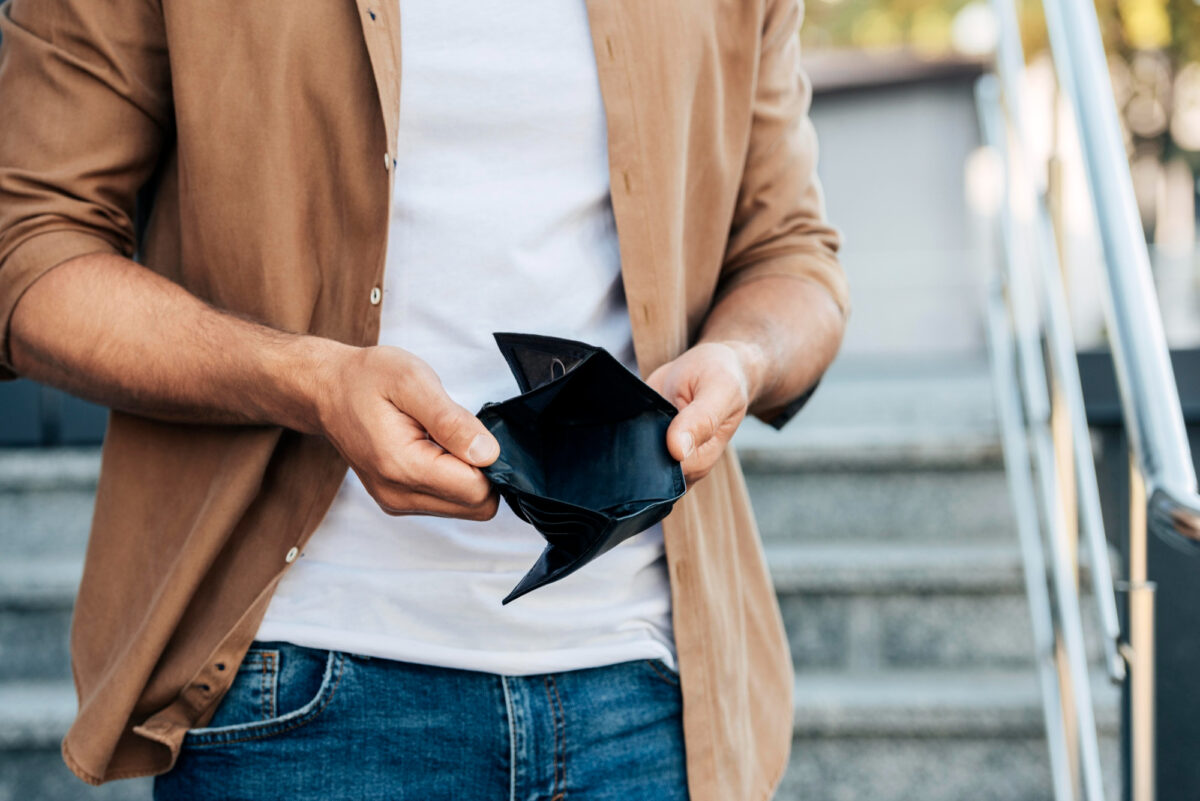 close-up-hands-holding-empty-wallet